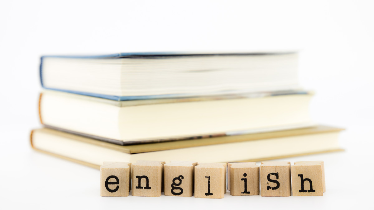 Stack of books and wording in english